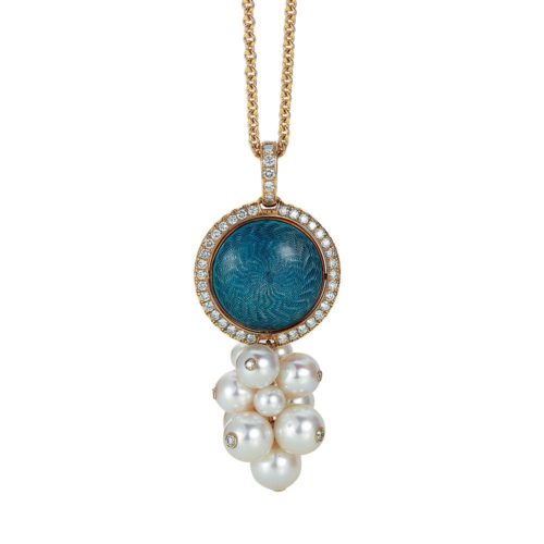 Gold pendant with blue and silver enamel on guilloche with diamonds and Akoya pearls around the rotatable middle part