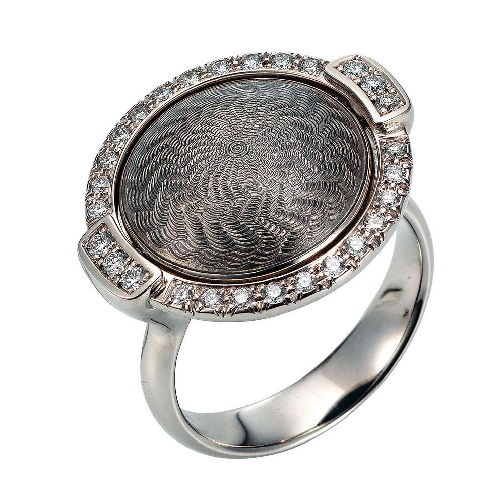Gold-Ring mit blau bzw. silber emailliertem Guilloche und Diamanten um das drehbare Mittelteil