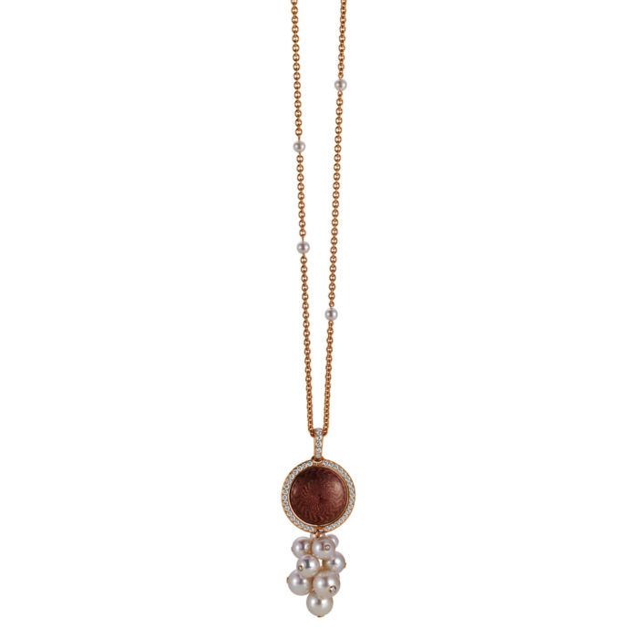 Gold pendant with aubergine and red enamel on guilloche with diamonds and Akoya pearls around the turnable middle part