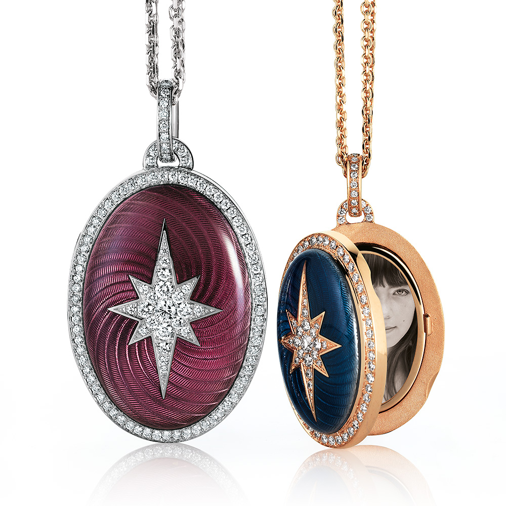Two lockets with diamond star and halo, pink and blue vitrous enamel. One locket is open an features a miniature portrait of a young lady