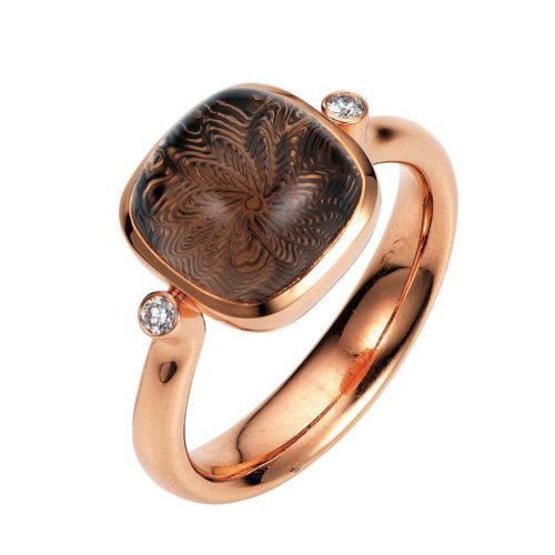 Gold ring with brown gemstone on guilloched surface and diamonds