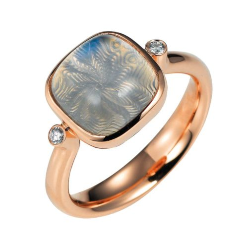 Gold ring with blue shimmering gemstone moonstone on guilloched surface with diamonds