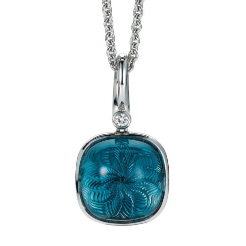 Gold pendant with blue gemstone on guilloched surface with diamonds