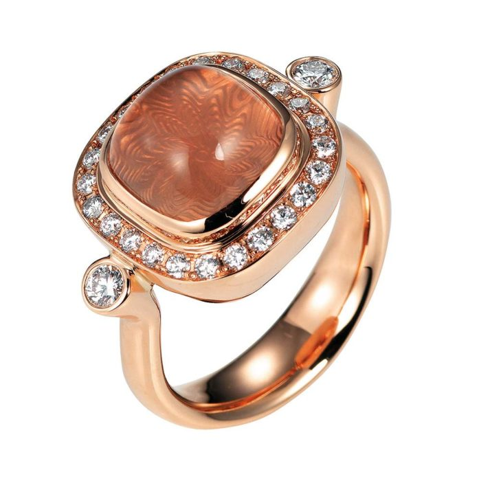 Gold ring with diamonds and peach coloured gemstone