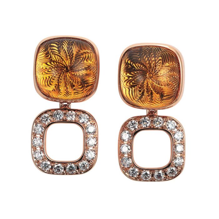 Gold earrings with yellow gemstone and diamonds