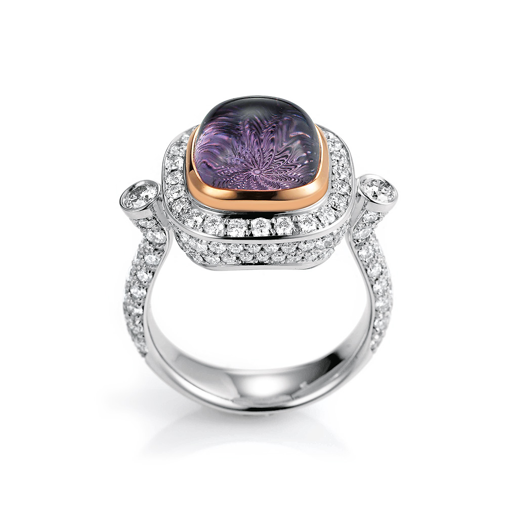 Gold ring with diamonds and purple gemstone amethyst