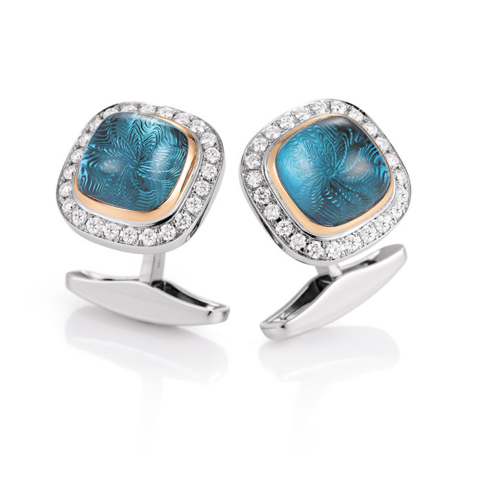 Gold cufflinks with blue gemstone and diamonds
