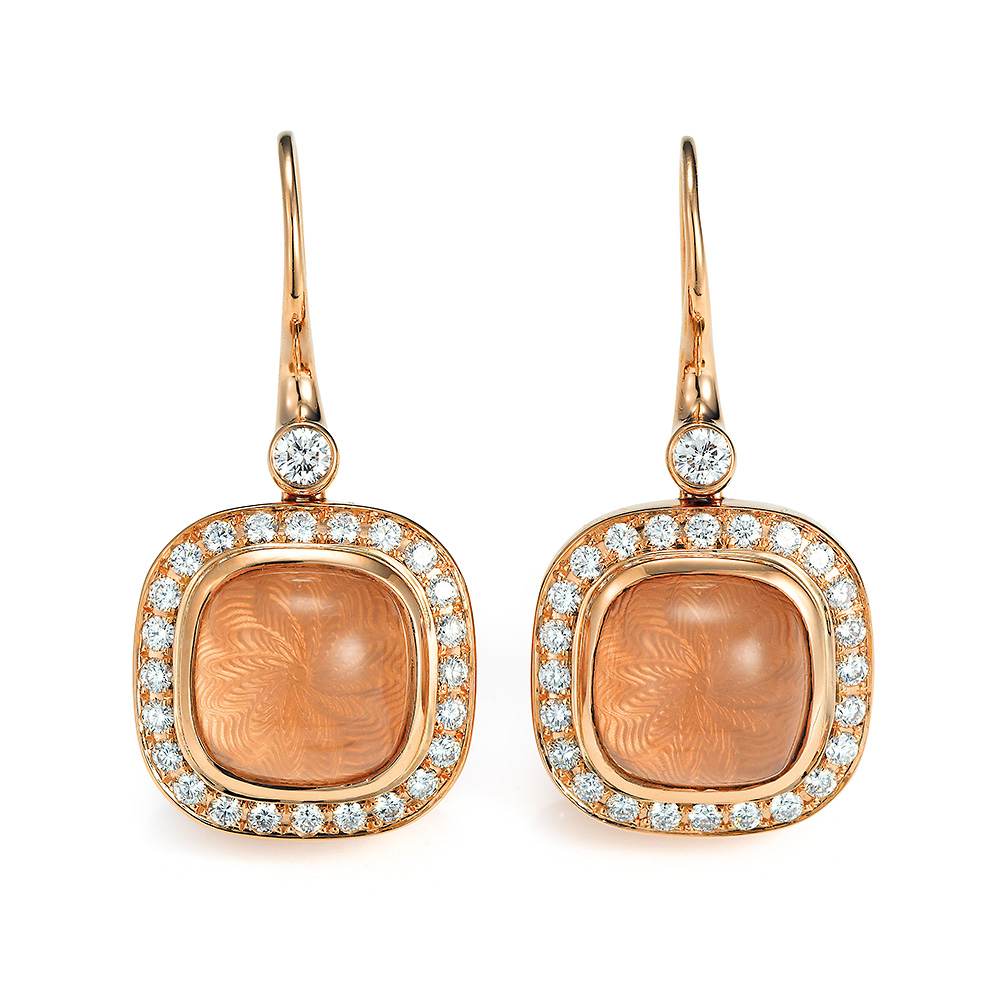Gold earrings with peach coloured gemstone and diamonds