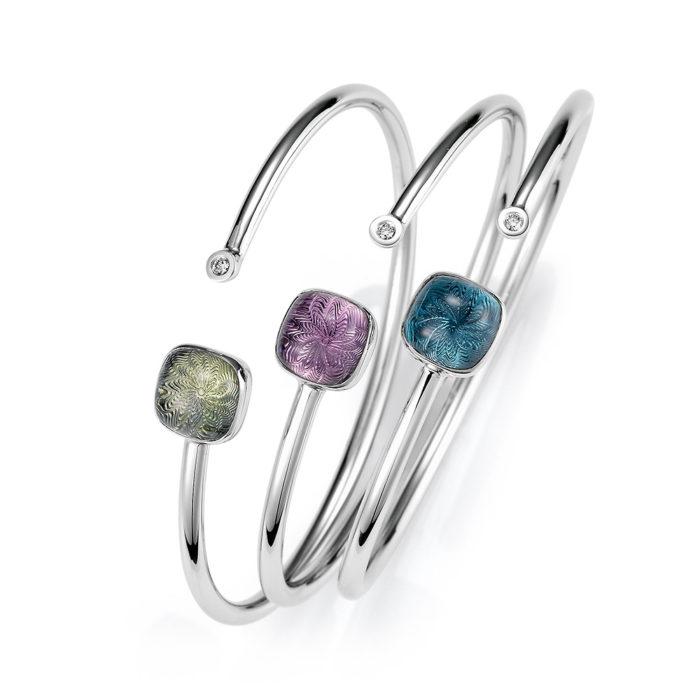 Gold bracelet with diamonds and blue gemstone