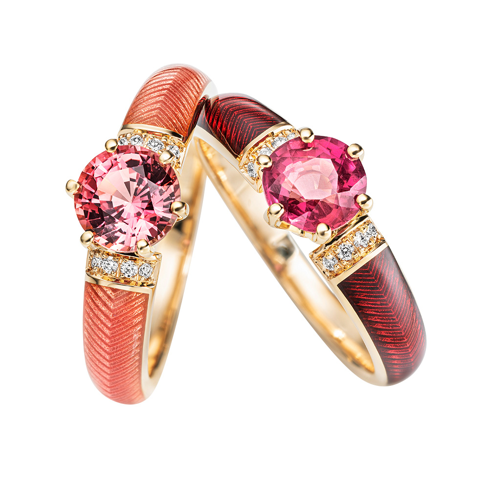 Two Diamond-set gold solitaire rings with red and pink fire enamel and padparajah sapphires