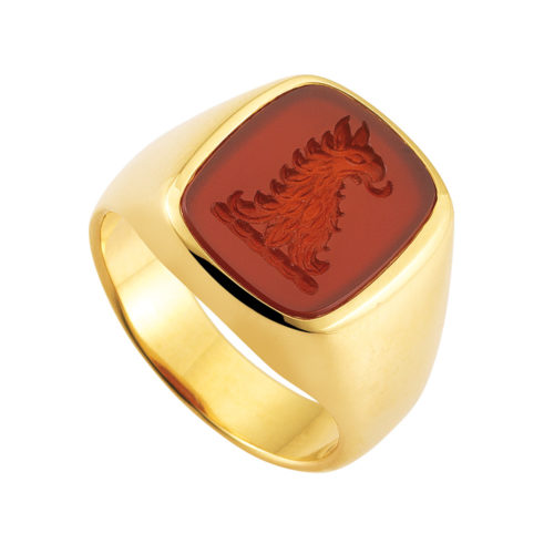 yellow gold signet-ring with cushion shape carnelian with an engraved helmet crest