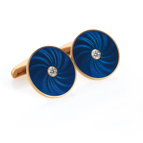 Round diamond set gold cuff links with blue vitreous guilloché enamel with a windmill pattern
