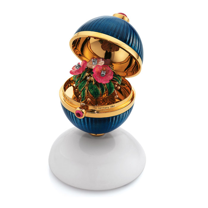 Golden object to open with medium blue enamelled guilloche, diamonds, pink tourmalines, Cocolong foot and surprise inside.