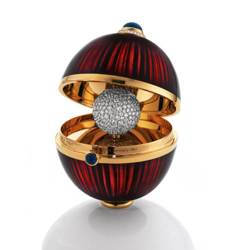 Golden egg object to open with aubergine red enamelled guilloche, diamonds, sapphires, Cocolong foot and surprise inside.